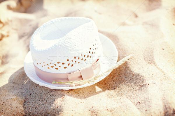 белый соломенной шляпе песок пляж лет Сток-фото © dolgachov