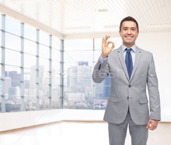 happy businessman in suit showing ok hand sign Stock photo © dolgachov