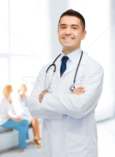 smiling male doctor in white coat at hospital Stock photo © dolgachov