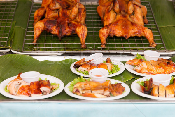grilled or fried chicken on plate at street market Stock photo © dolgachov