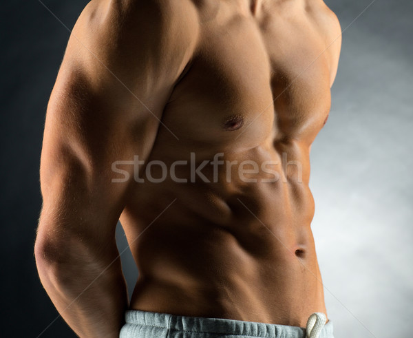 close up of young male bodybuilder Stock photo © dolgachov