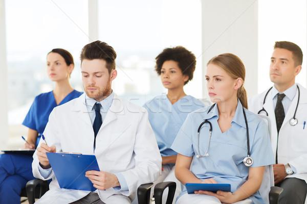 group of happy doctors on seminar at hospital Stock photo © dolgachov