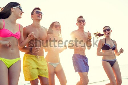 group of happy women pointing at you on beach Stock photo © dolgachov