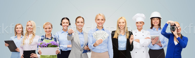 Stock photo: woman holding money over professional workers