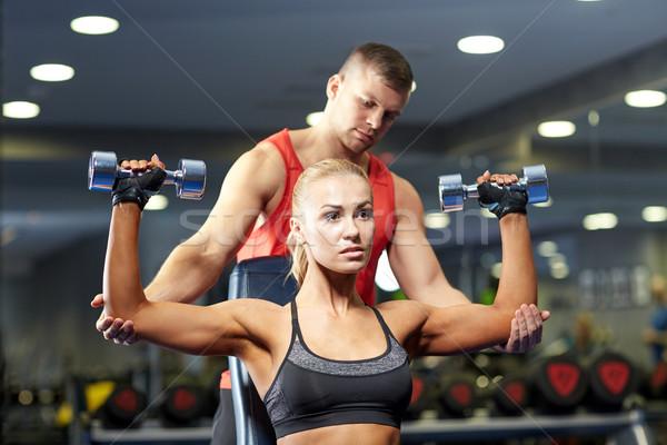 Homme femme haltères gymnase sport fitness Photo stock © dolgachov