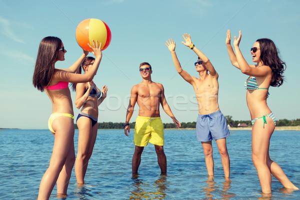 Sonriendo amigos gafas de sol verano playa amistad Foto stock © dolgachov