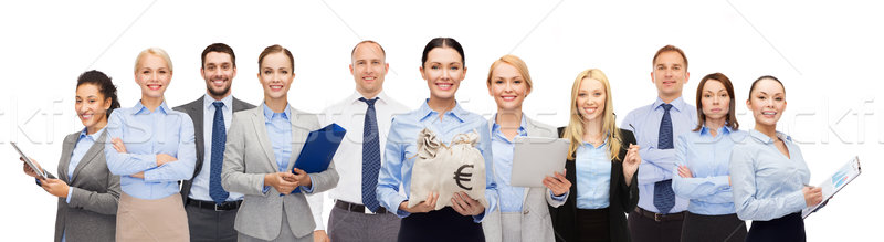group of happy businesspeople with money bags Stock photo © dolgachov