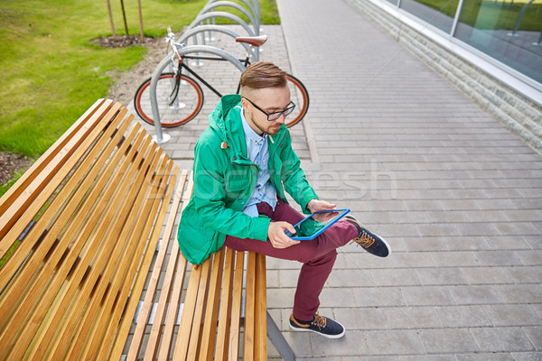 happy young hipster man with tablet pc and bike Stock photo © dolgachov