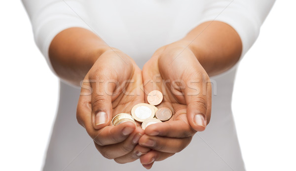 womans cupped hands showing euro coins Stock photo © dolgachov
