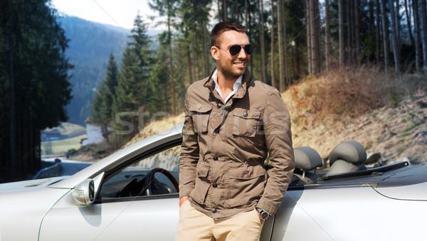 Feliz hombre cabriolé coche naturaleza viaje Foto stock © dolgachov