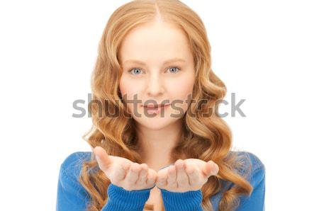 woman holding big diamond over blue background Stock photo © dolgachov
