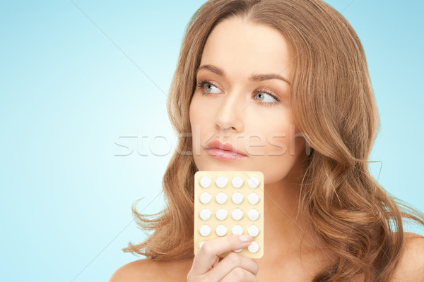 beautiful young woman with medication Stock photo © dolgachov