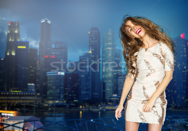 happy young woman or teen girl over night city Stock photo © dolgachov