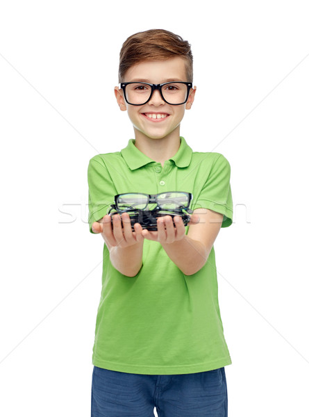 happy boy in green polo t-shirt holding eyeglasses Stock photo © dolgachov