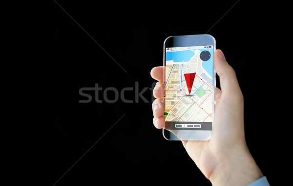 close up of male hand with transparent smartphone Stock photo © dolgachov