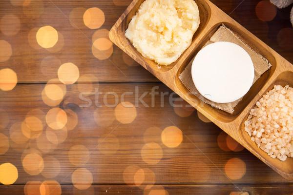 close up of soap, himalayan salt and body scrub Stock photo © dolgachov
