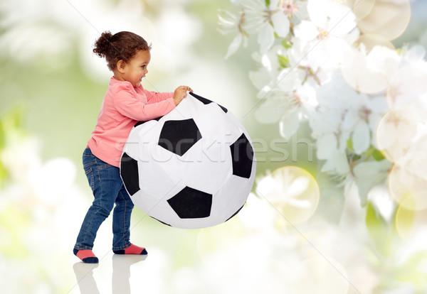 Feliz pequeño jugando pelota infancia Foto stock © dolgachov