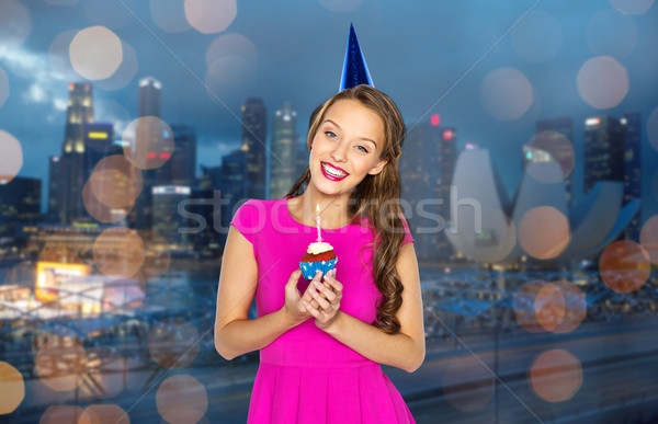 Stock photo: happy woman or teen girl with birthday cupcake
