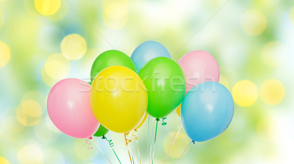 bunch of helium balloons over green lights Stock photo © dolgachov
