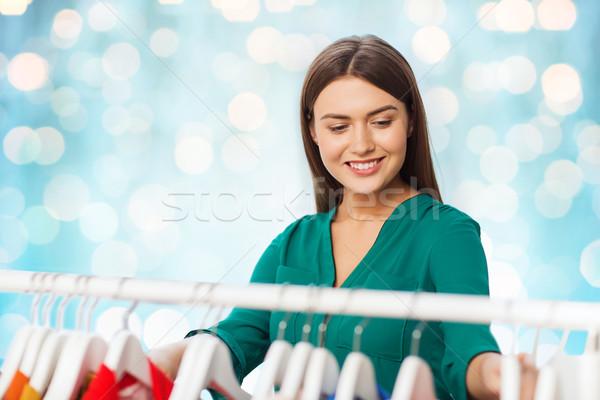 Heureux femme vêtements armoire vêtements Photo stock © dolgachov