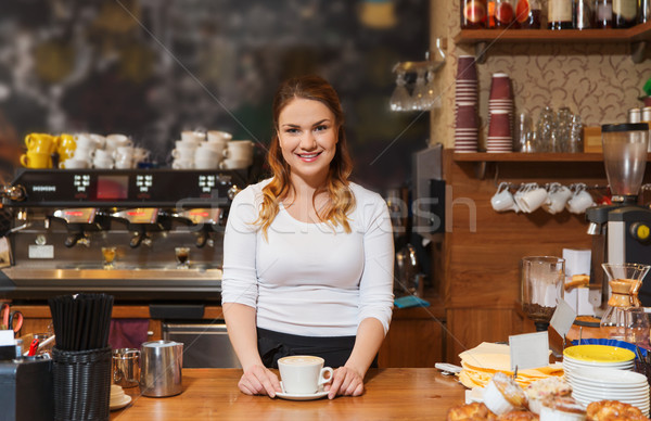 happy barista woman with latte at coffee shop Stock photo © dolgachov