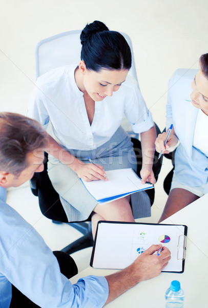 üzleti csapat megbeszélés iroda barátságos üzlet megbeszélés Stock fotó © dolgachov