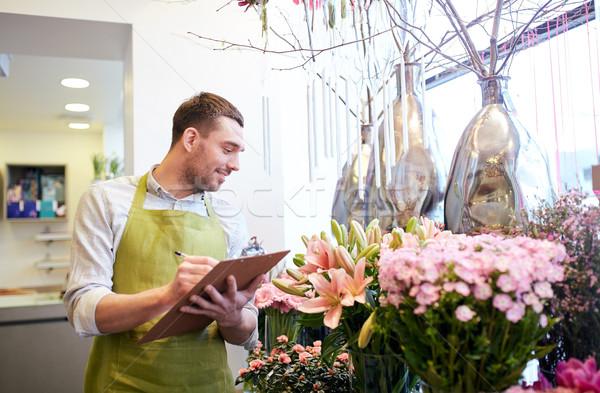 Florista hombre portapapeles personas venta Foto stock © dolgachov