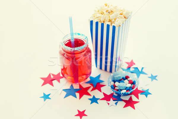 drink and popcorn with candies on independence day Stock photo © dolgachov