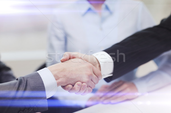 two businessmen shaking hands in office Stock photo © dolgachov