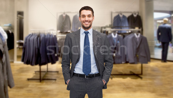 happy young businessman over clothing store Stock photo © dolgachov