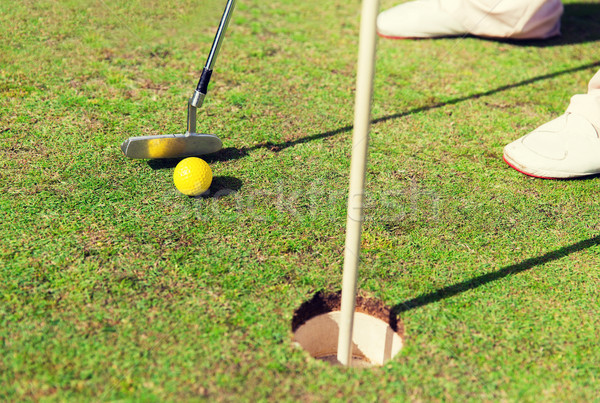 close up of man with club and ball playing golf Stock photo © dolgachov