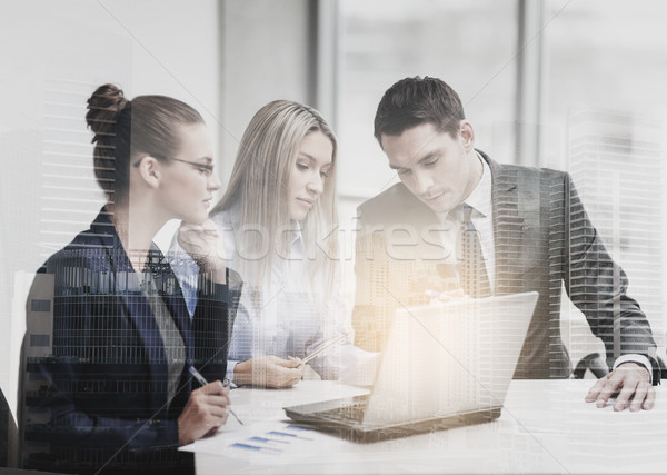 business team with laptop having discussion Stock photo © dolgachov