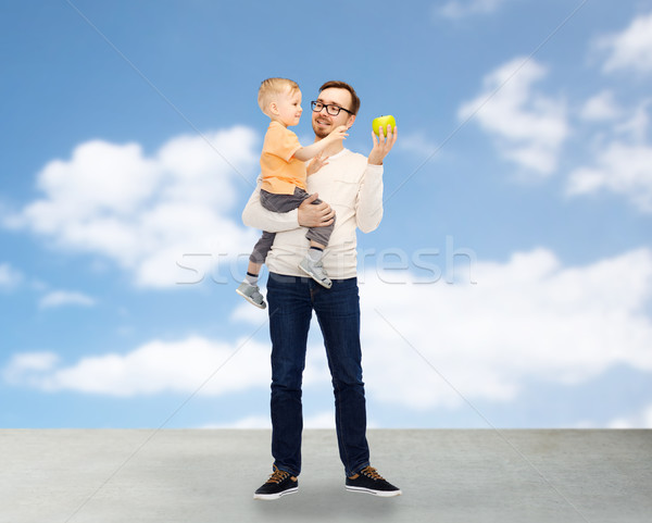 Stock photo: happy father and little son with green apple