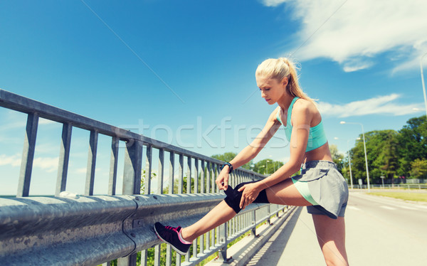 young woman with injured knee or leg outdoors Stock photo © dolgachov