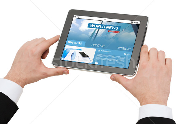 close up of hands with business news on tablet pc Stock photo © dolgachov