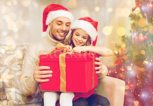 Stock photo: smiling father and daughter opening gift box