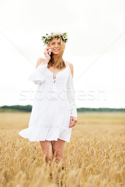 Stock photo: happy young woman calling on smartphone at country