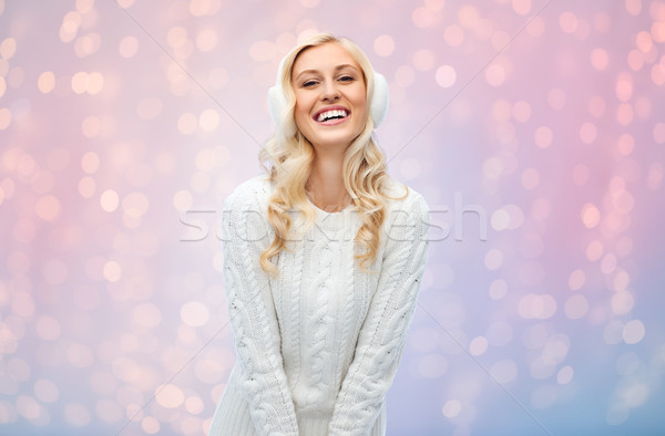 smiling young woman in winter earmuffs and sweater Stock photo © dolgachov