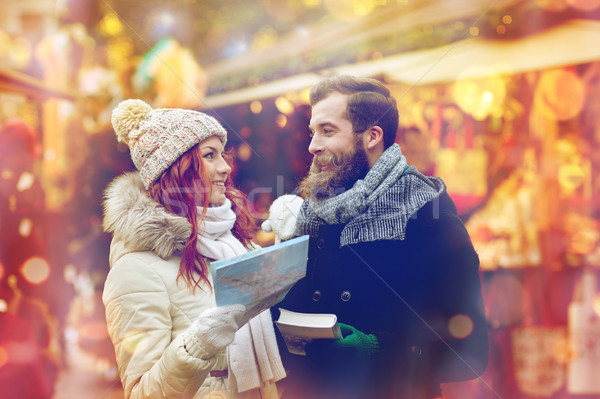 happy couple with map and city guide in old town Stock photo © dolgachov