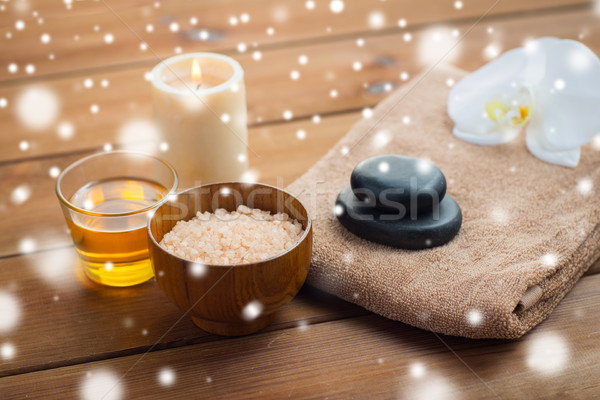 himalayan pink salt with honey and bath towel Stock photo © dolgachov