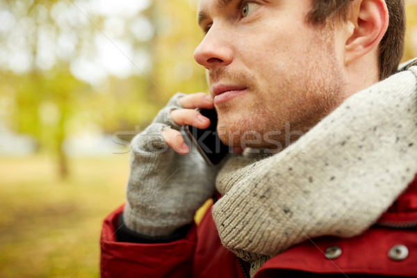 close up of man with smartphone calling in autumn Stock photo © dolgachov