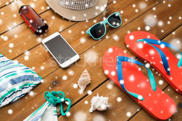 smartphone and beach stuff Stock photo © dolgachov