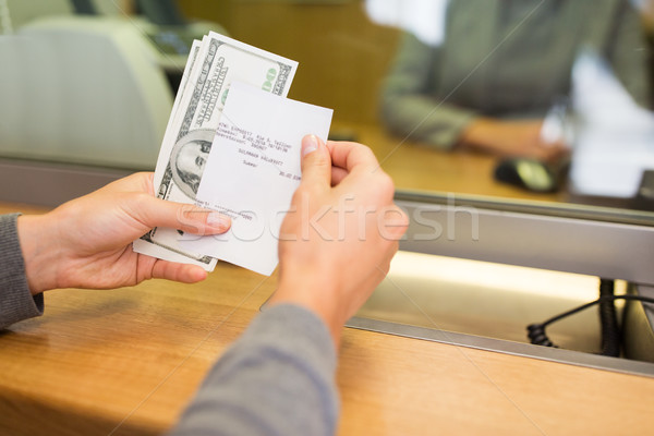 customer with money and receipt at bank counter Stock photo © dolgachov