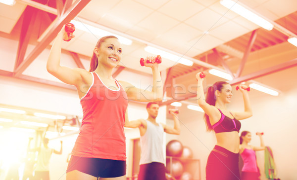 group of people working out with dumbbells Stock photo © dolgachov