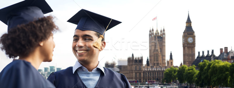 happy students or bachelors over london Stock photo © dolgachov