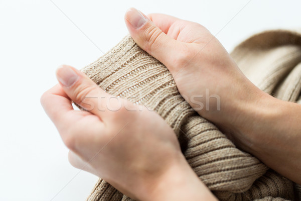 close up of hands with knitted clothing item Stock photo © dolgachov
