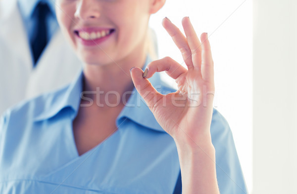 close up of doctor or nurse showing ok sign Stock photo © dolgachov