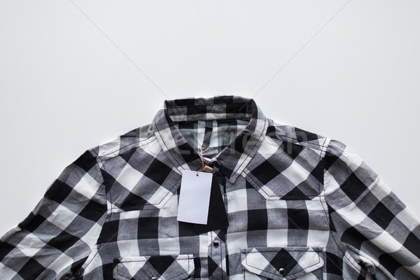 close up of checkered shirt on white background Stock photo © dolgachov