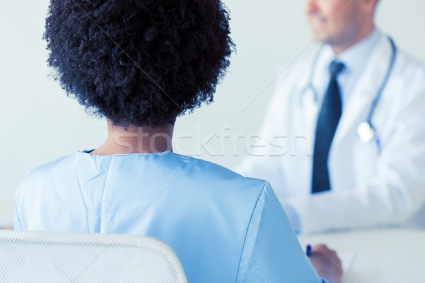 Közelkép afrikai orvos kórház hát hivatás Stock fotó © dolgachov