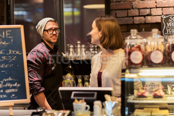 happy bartenders at cafe or coffee shop counter Stock photo © dolgachov